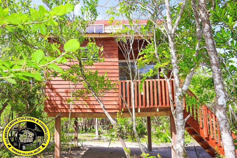 Palmento Grove Cultural & Fishing Lodge -Iseini Cabin, vacation rental in Tobacco Caye