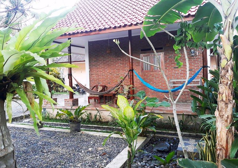 Cozy Bungalow - Ragha Homestay, location de vacances à Batu Karas