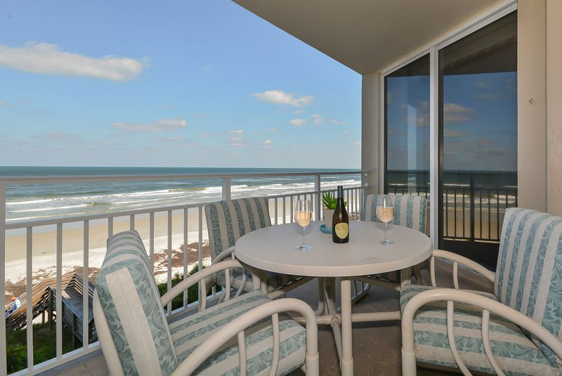 Private oceanfront balcony with table for 4.