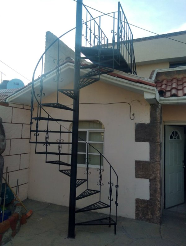 Front of property. Stairs leading to Master suite.