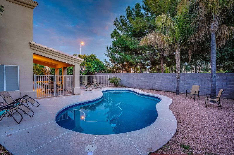 This vacation rental home in Chandler has 6 bedrooms and 4.5 bathrooms.
