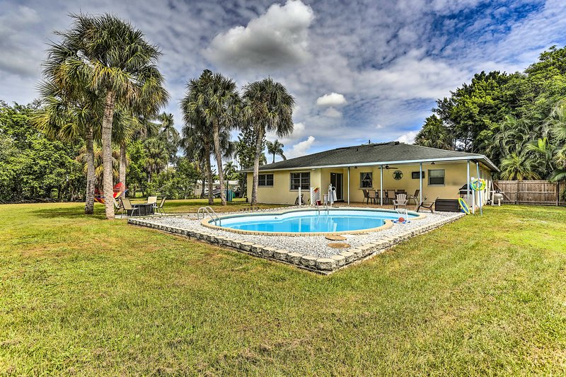 This vacation rental house features a private pool, patio, fire pit, & hammock.