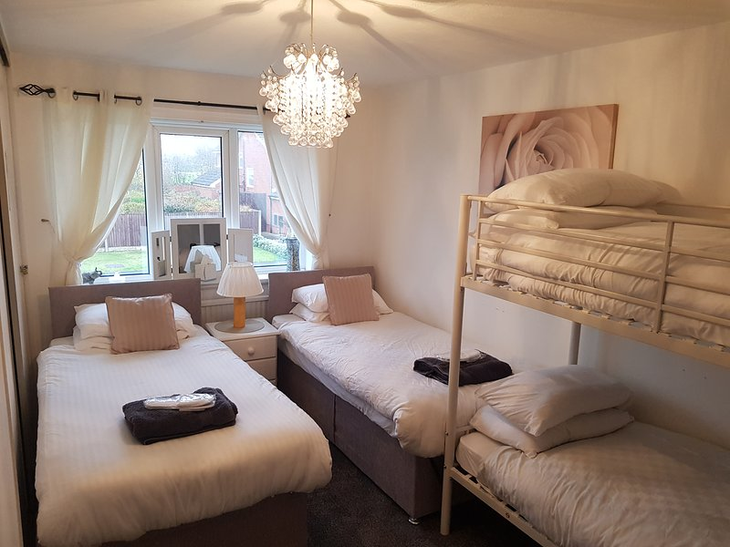 Main Bedroom(family room) contains 2 beds which can also be made into king size double with bunk bed