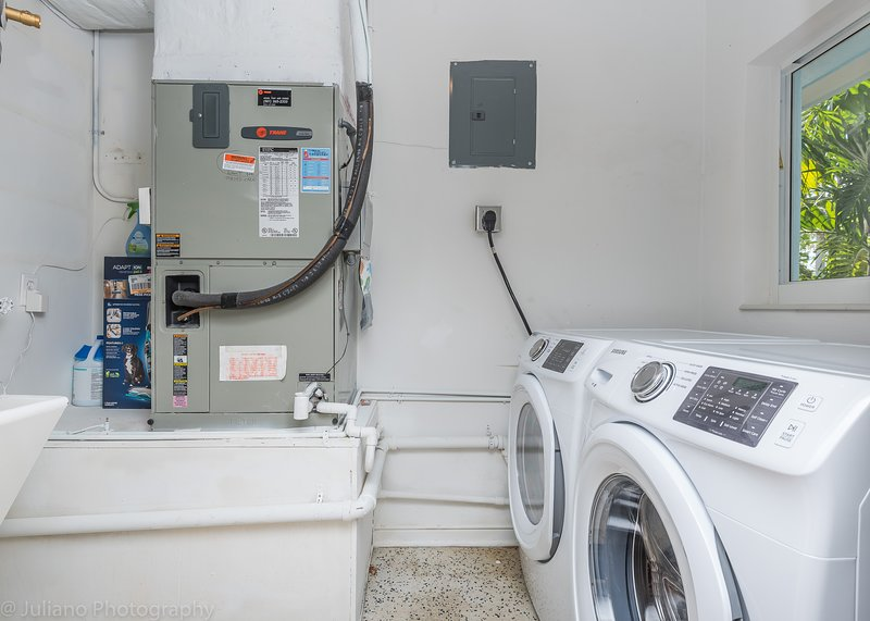 Equipped laundry room provides basic cleaning items (vacuum, detergents)