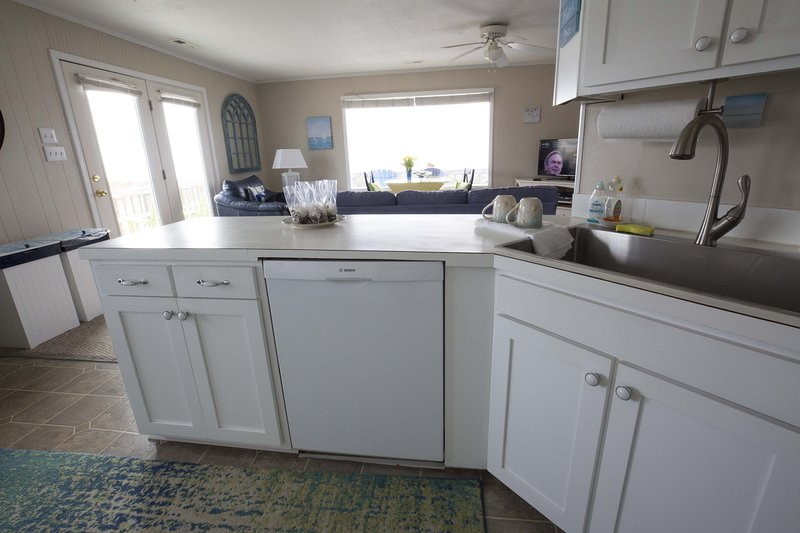 Fix your food while watching crashing waves. Enjoy the new cabinets, new sink and new dishwasher.