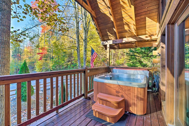 This vacation rental cabin has 2 bedrooms, 2 baths, and a private hot tub!