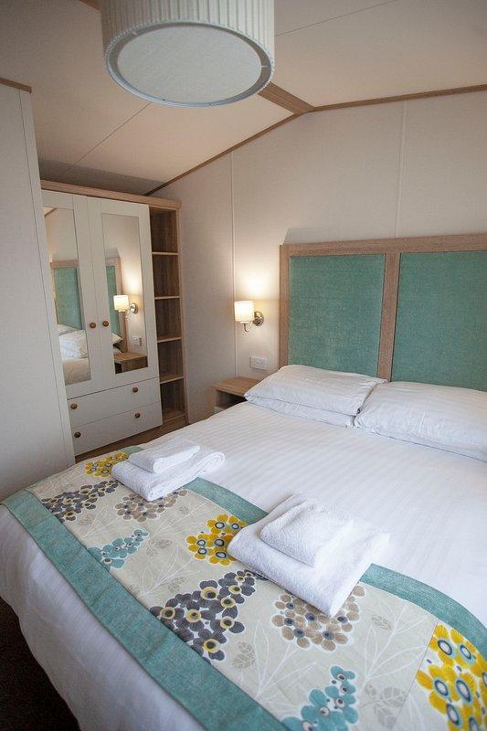 Master bedroom with king size bed. USB charging points on plug sockets. En-suite shower room