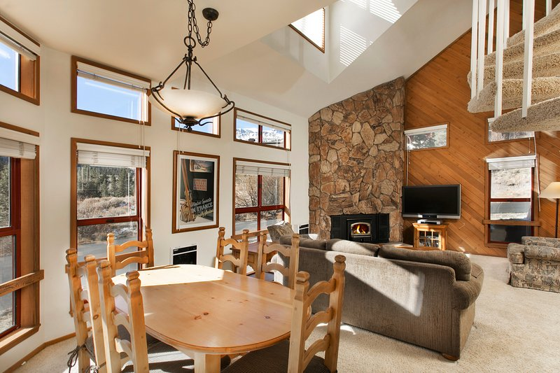 Aspen Creek #4 Living Area With A Wood Burning Fireplace Place And A Dining Table