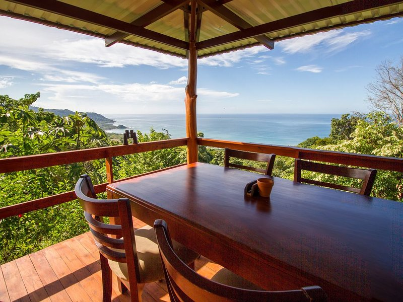 Enjoy your meals here at this custom teak dining table overlooking the Pacific