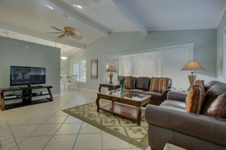 The living room is bright and open with volume ceilings.  Enjoy the flat screen TV with cable and WiFi.