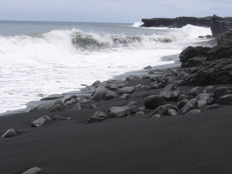 Spectacular true black sand beach at nearby Kaimu