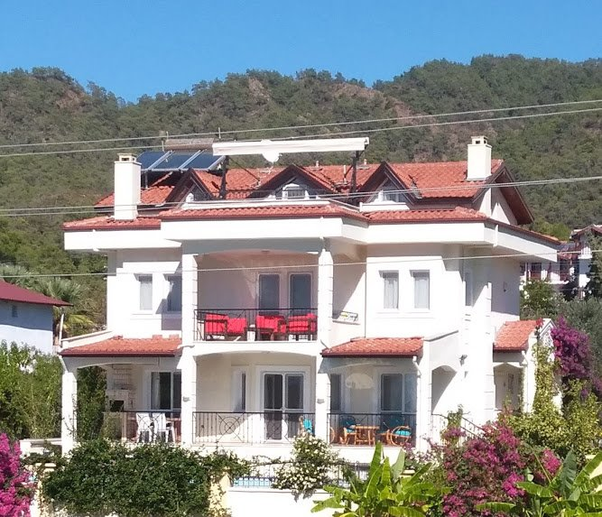 Large terrace, generous upper floor balconies, with the Toros mountains just behind the villa.