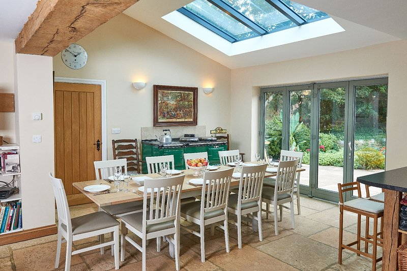 The open plan ground floor showing the dining area and bifold doors onto the garden terrace