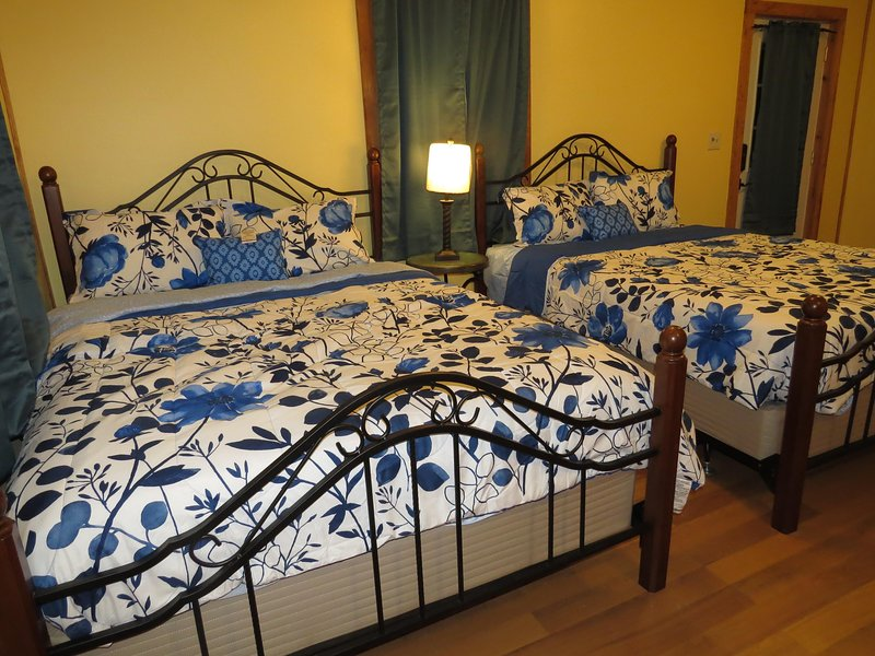 Two queens beds perfect for couples or a family of four