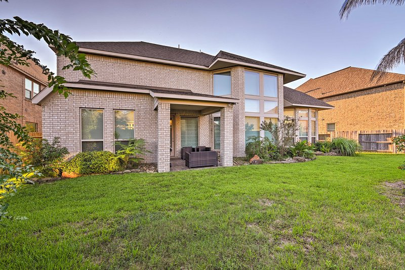 This Pearland getaway features a large fenced-in yard and patio.