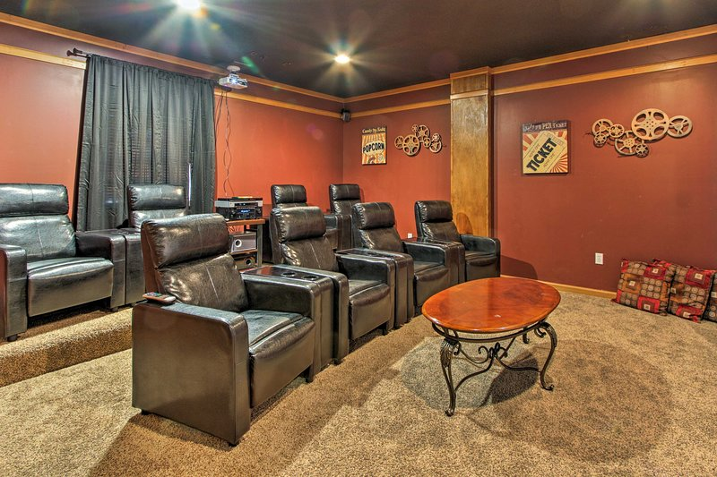 This 5-bed, 4.5-bath Gatlinburg vacation rental has room for 18 & a theater.