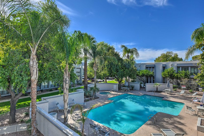 Soak up Arizona rays poolside at this vacation rental condo in The Cloisters.