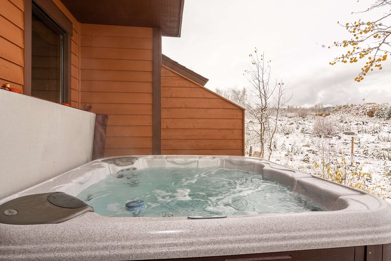 Let your worries melt away in the private hot tub on the patio