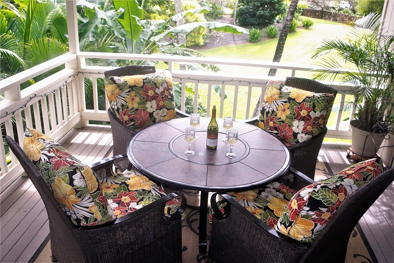 Extra large lanai overlooking the gardens, pool, tennis court and putting green.