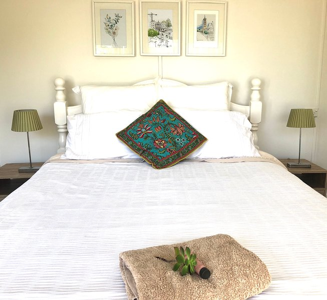 Queen size bed with quality linen