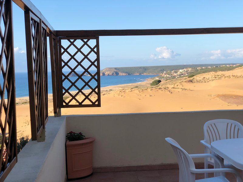 Terrace overlooking the sea and dunes for alfresco dining at sunset