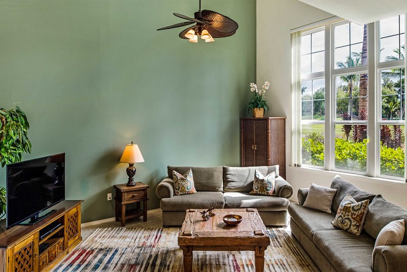 Sunlight Bathes the Living Room Through Large Picture Windows