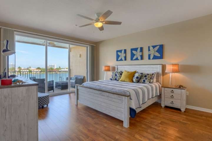 Spacious Master Bedroom with King Size Bed and Access to Private Balcony