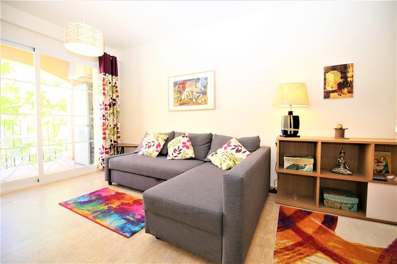 Spacious and bright lounge with comfortable seating and terrace access