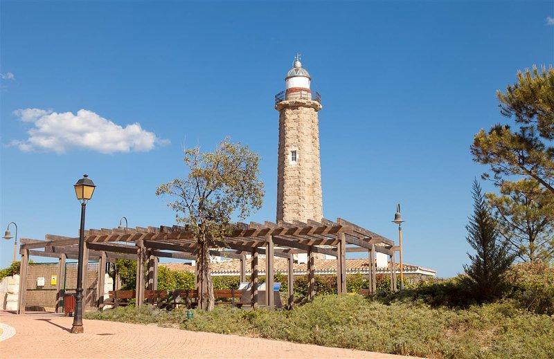 Lighthouse in Estepona between the marina and La Rada Beach