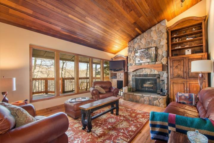 Natural lighting and panoramic views invite family and friends to gather in the living area.