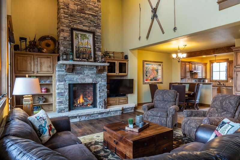 Cozy up next to the huge fireplace in the living area after a long and adventurous day