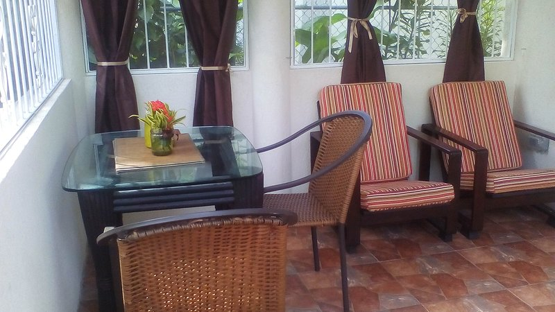 Private, covered patio, with security bars, insect screens and patio gate.