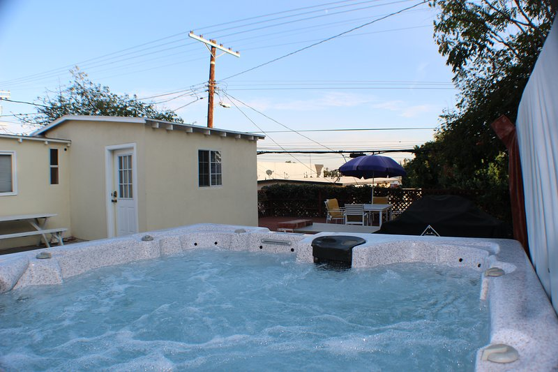 guests have use of hot tub and yard