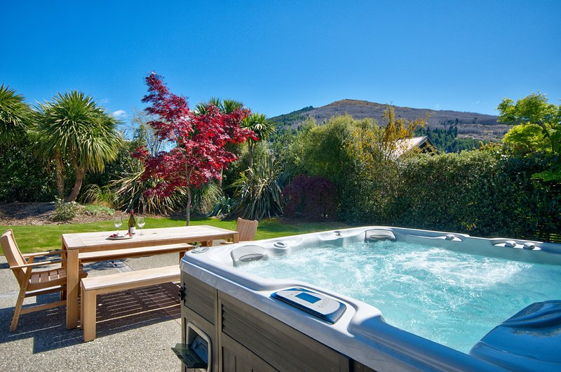 Outdoor spa in backyard - great for relaxing after a day skiing or exploring.