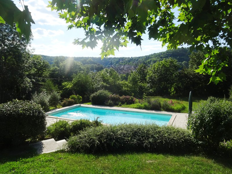 Private pool & peaceful gardens - fabulous views, walking distance to town for a, holiday rental in Ginals