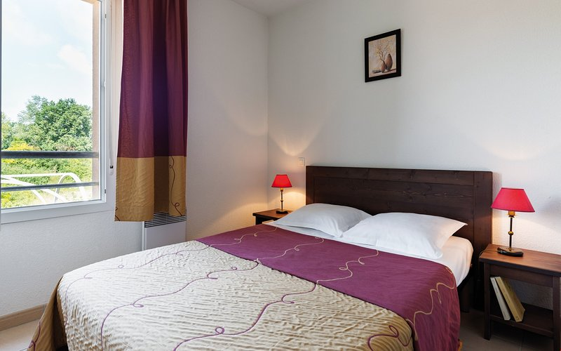 The cozy bedroom features a Double bed.
