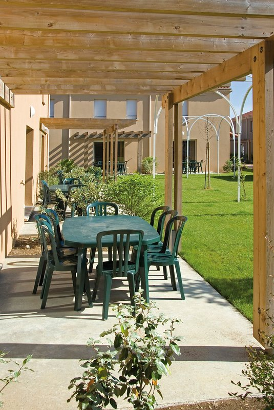 Soak up the sun in your lovely private furnished garden area.
