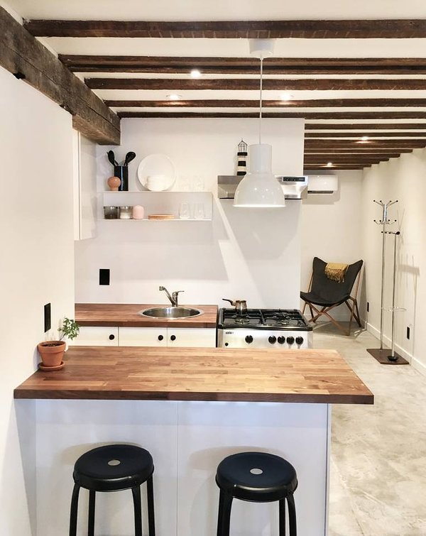 Full kitchen with island and seating for two