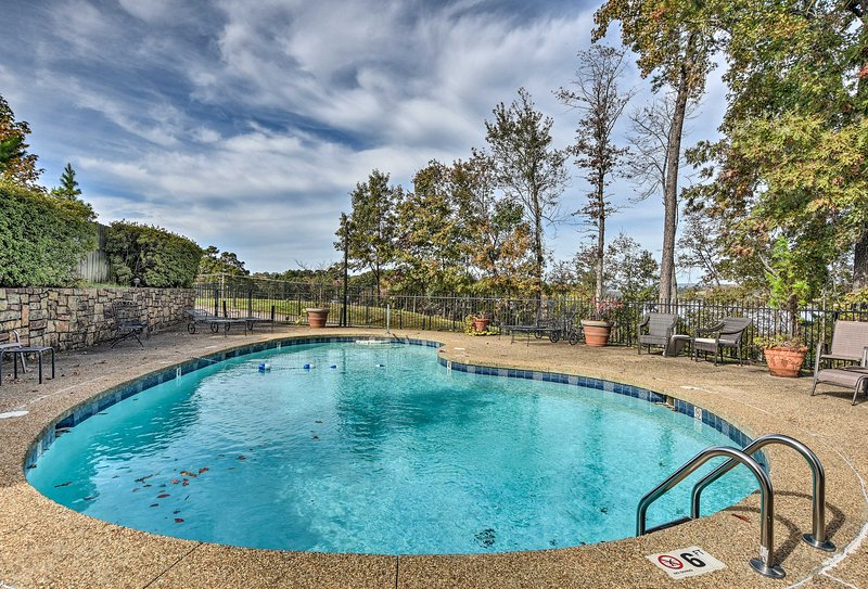 Swim laps in the community pool of this Hot Springs vacation rental condo.