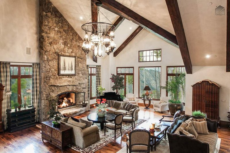 An abundance of light fills this oversized space, tastefully filled with comfortable seating