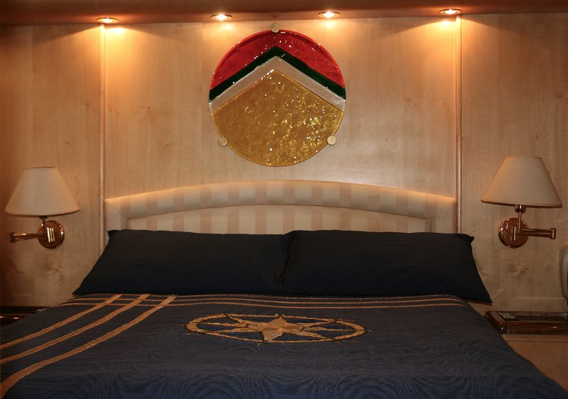 Owners stateroom for two people queen bed  en-suite bathroom with shower room and bidet