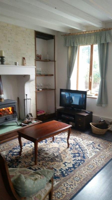 Lounge with TV and cosy wood burner