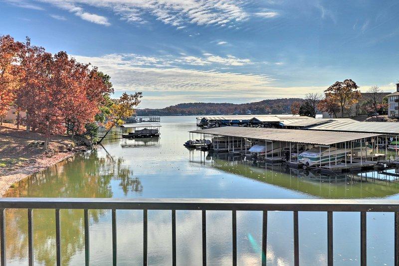 Wake up to lakefront views at this cozy Lake Ozark vacation rental condo!