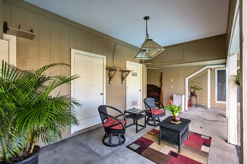 The home - set on the upper level beside the pool - boasts a comfortable patio.