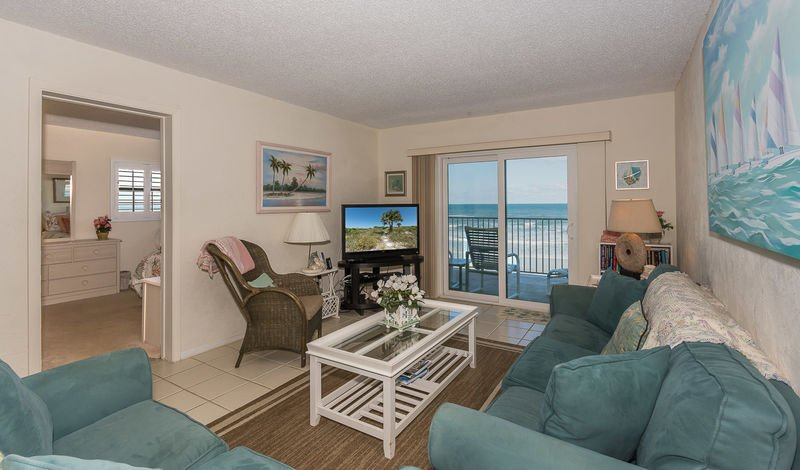 Oceanfront living room with TV, DVD, recliner and sofa sleeper.