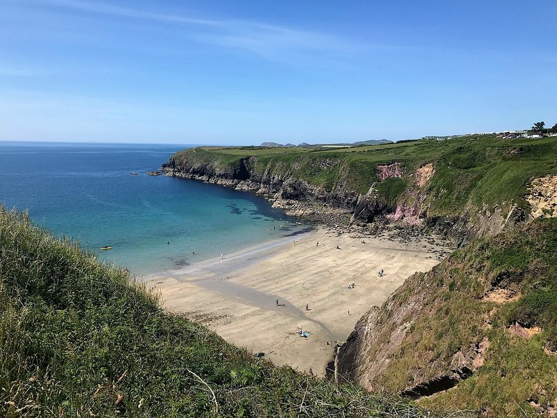 Explore the stunning coastal path and the bays along the way