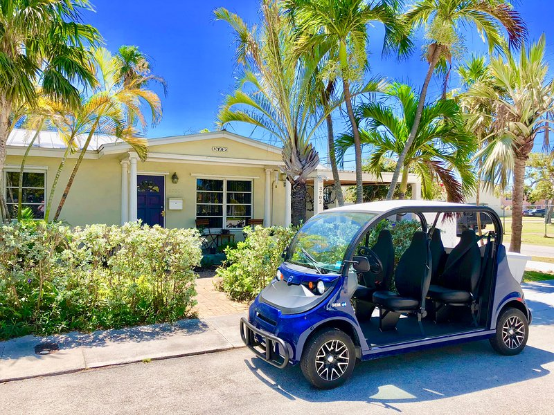 Front of house with GEM electric car