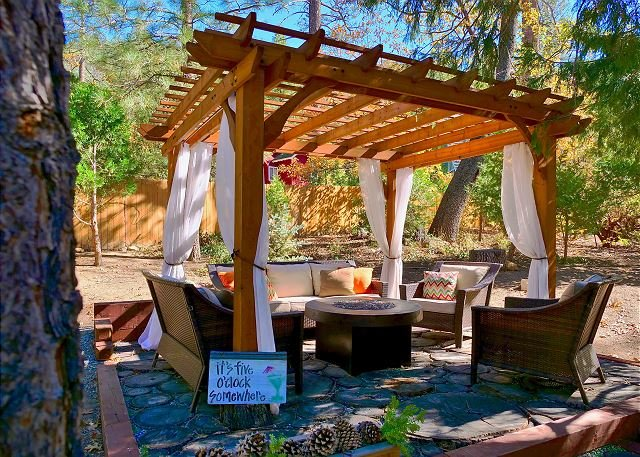 Outdoor gazebo with firepit.