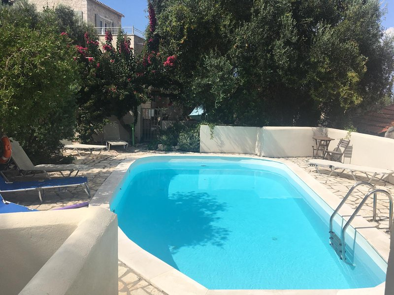 Orkos Studio with pool close to Lakka, vacation rental in Lakka