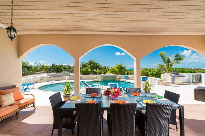 Patio leading unto pool deck with beautiful view of the Long Bay beach; only 3 minutes drive away.